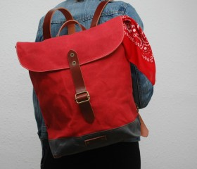 Waxed canvas rucksack, red color.