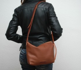 messenger bag , made of soft leather ,high quality ,caramel color , with leather handles,metalic ykk zip