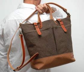 waxed canvas bag with leather handles and closures, khaky color