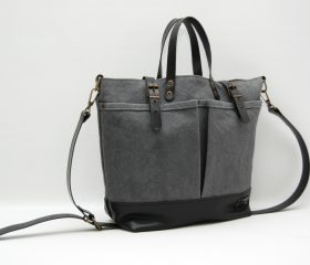 waxed canvas bag with leather handles and closures,