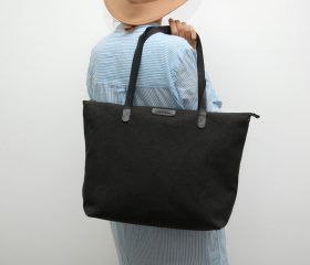 waxed canvas bag with leather handles and closures,black color
